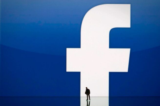 A picture taken on May 14, 2012 in Paris, shows an illustration made with a figurine set up in front of Facebook's homepage. Facebook, already assured of becoming one of the most valuable US firms when it goes public later this month, now must convince investors in the next two weeks that it is worth all the hype. Top executives at the world's leading social network have kicked off their all-important road show on Wall Street -- an intense marketing drive ahead of the company's expected trading launch on the tech-heavy Nasdaq on May 18. AFP PHOTO/JOEL SAGET (Photo by Joël SAGET / AFP)        (Photo credit should read JOEL SAGET/AFP via Getty Images)