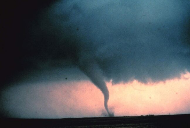 View of the 'rope' or decay stage of tornado seen during 'Sound Chase,' a joint project of NSSL and Mississippi State University in Cordell, Oklahoma May 22, 1981. (Photo by NOAA Photo Library/Getty Images)
