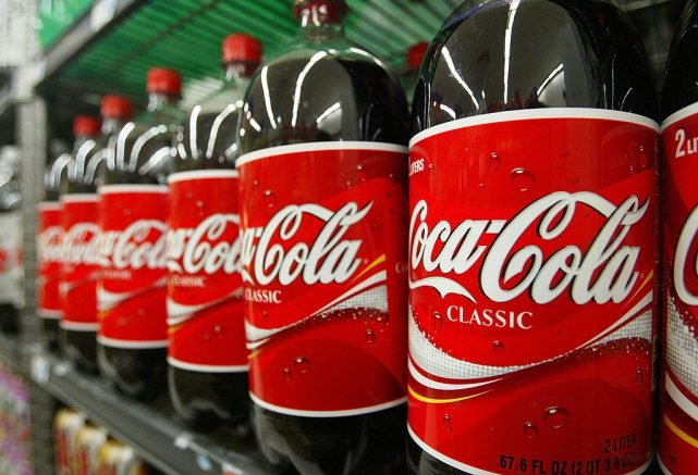 SAN FRANCISCO - JANUARY 16: Bottles of Coca-Cola are seen on the shelf at Tower Market January 16, 2004 in San Francisco, California. Coca-Cola is being investigated by U.S. regulators over allegations raised by a former employee that it had inflated its earnings. (Photo by Justin Sullivan/Getty Images)