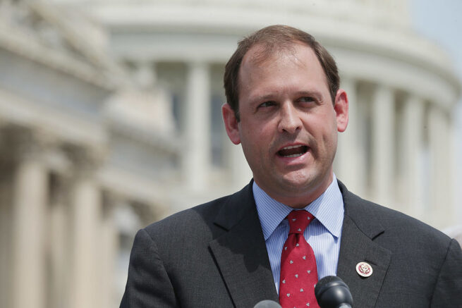 """WASHINGTON, DC - MAY 20:  U.S. Rep. Andy Barr (R-KY) speaks during a news conference with a bipartisan group of House members outside the U.S. Capitol May 20, 2014 in Washington, DC. U.S. Rep. Patrick Murphy (D-FL) and U.S. Rep. Mick Mulvaney (R-SC) are co-sponsoring legislation 'aimed at modernizing America's regulatory system to reduce compliance costs, encourage growth and innovation, and improve national competitiveness.""""  (Photo by Chip Somodevilla/Getty Images)"""