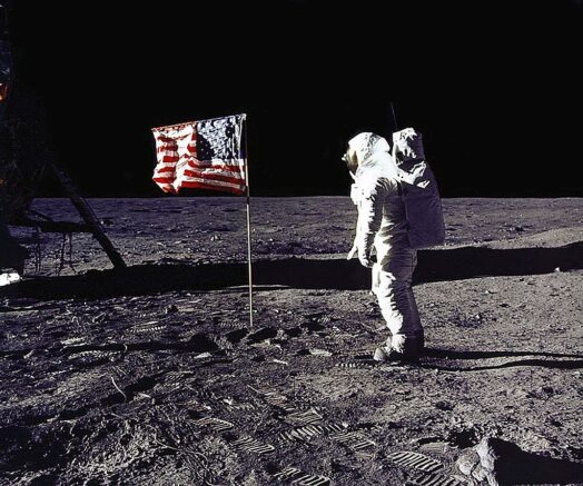 """DC, UNITED STATES: This 20 July 1969 file photo released by NASA shows astronaut Edwin E. """"Buzz"""" Aldrin, Jr. saluting the US flag on the surface of the Moon during the Apollo 11 lunar mission. The 20th July 1999 marks the 30th anniversary of the Apollo 11 mission and man's first walk on the Moon. AFP PHOTO NASA (Photo credit should read NASA/AFP via Getty Images)"""