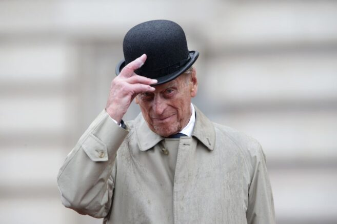 LONDON, ENGLAND - AUGUST 2: Prince Philip, Duke of Edinburgh raises his hat in his role as Captain General, Royal Marines, makes his final individual public engagement as he attends a parade to mark the finale of the 1664 Global Challenge, on the Buckingham Palace Forecourt on August 2, 2017 in London, England. (Photo by Yui Mok - WPA Pool/Getty Images)