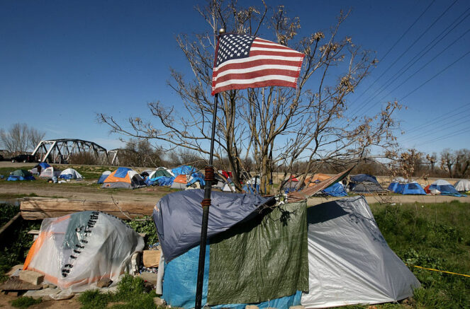 SACRAMENTO, CA - MARCH 10: An American flag files March 10, 2009 in Sacramento, California. This tent city of the homeless is seeing an increase in population as the economy worsens, as more people join the ranks of the unemployed and as homes slip into foreclosure. (Photo by Justin Sullivan/Getty Images)