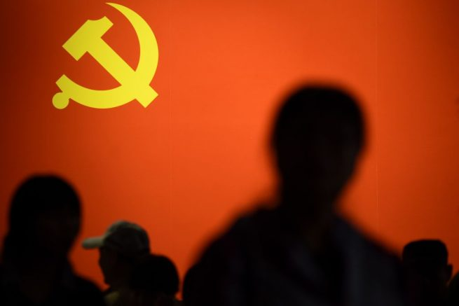TOPSHOT - This picture taken on October 10, 2017 shows a party flag of the Chinese Communist Party displayed at an exhibition showcasing China's progress in the past five years at the Beijing Exhibition Center.<br /> China's police and censorship organs have kicked into high gear to ensure that the party's week-long, twice-a-decade congress goes smoothly when it begins on October 18. / AFP PHOTO / WANG ZHAO / TO GO WITH CHINA-POLITICS-SECURITY, FOCUS BY BECKY DAVIS (Photo credit should read WANG ZHAO/AFP via Getty Images)