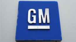 FILE - This Jan. 27, 2020, file photo shows a General Motors logo at the General Motors Detroit-Hamtramck Assembly plant in Hamtramck, Mich. General Motors is recalling more than 10,000 vans due to a fire risk and recommending that owners park them outdoors away from buildings and other structures until they are repaired. (AP Photo/Paul Sancya, File)