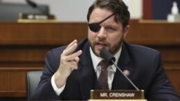 FILE - In this Sept. 17, 2020 file photo, Rep. Dan Crenshaw, R-Texas, questions witnesses during a House Committee on Homeland Security hearing on 'worldwide threats to the homeland' on Capitol Hill Washington. Crenshaw says he has undergone surgery on his eye and says he will be virtually sightless for a month. Crenshaw said in a news release Saturday, April 10, 2021, that an ophthalmologist on Thursday discovered the retina to his left eye was detaching. (Chip Somodevilla/Pool via AP, File)