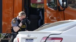 Authorities investigate gunfire that left one victim and the gunman dead, along with one person wounded, Wednesday, April 21, 2021, outside Wawa at Route 100 and Schantz Road in Breinigsville, Upper Macungie Township. (AP Photo/Matt Rourke)
