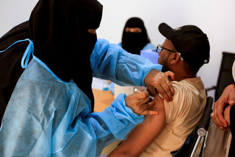 A man receives the AstraZeneca vaccine, at a medical center in Taiz