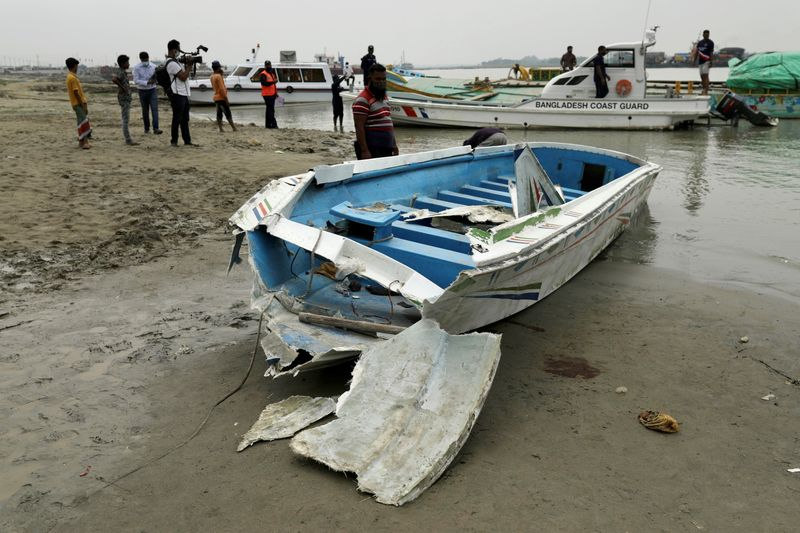 A speedboat is seen ashore after it collided with a sand-laden bulk carrier and sank on Padma River, in Madaripur