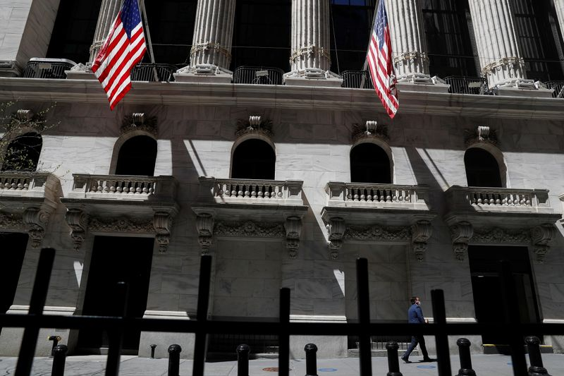 A trader walks outside the New York Stock Exchange in  New York City