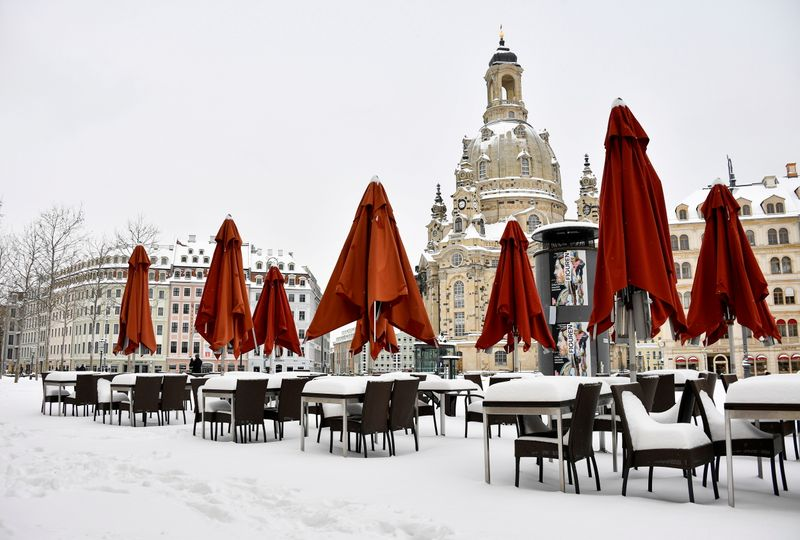 FILE PHOTO: Snow covered restaurant tables in Dresden