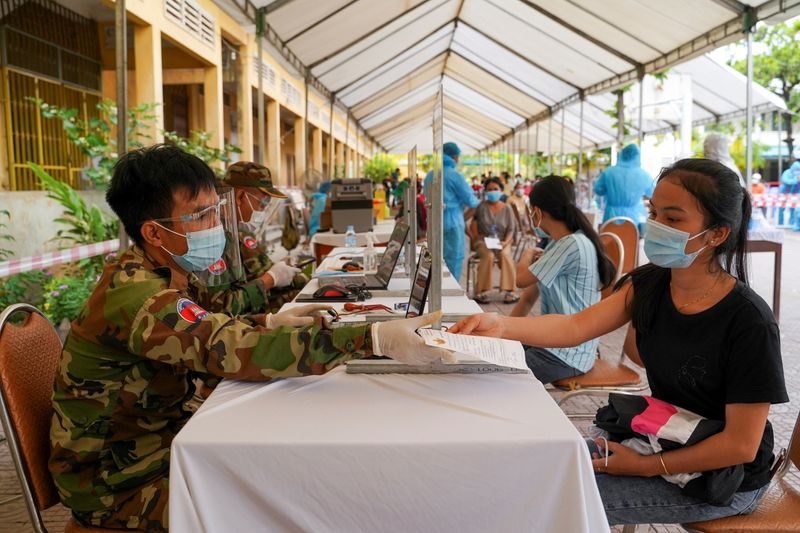 FILE PHOTO: Cambodian army members vaccinate people in Phnom Penh