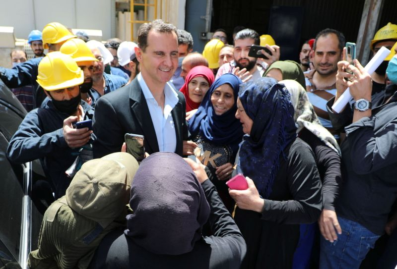 Syrian President Bashar al-Assad visits the industrial city of Hassia