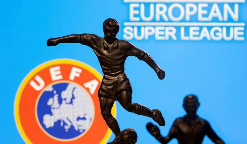FILE PHOTO: Metal figures of football players are seen in front of the words