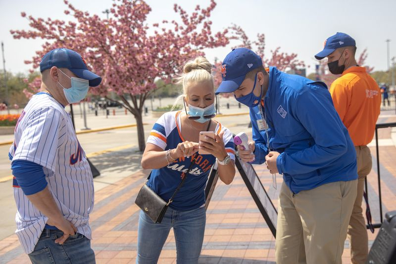 Fans arrive for a New York Mets game amid the coronavirus disease (COVID-19) pandemic, in Queens, New York