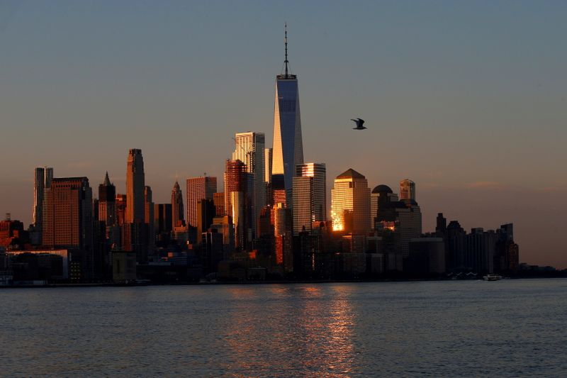 FILE PHOTO: A view of the One World Trade Centre tower and the lower Manhattan skyline of New York City at sunrise as seen from Hoboken
