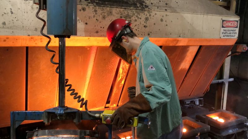 FILE PHOTO: A worker pours hot metal at the Kirsh Foundry in Beaver Dam