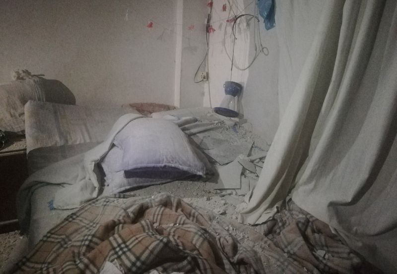 A view shows the damage inside a room after pre-dawn raids on the Mediterranean port region of Latakia