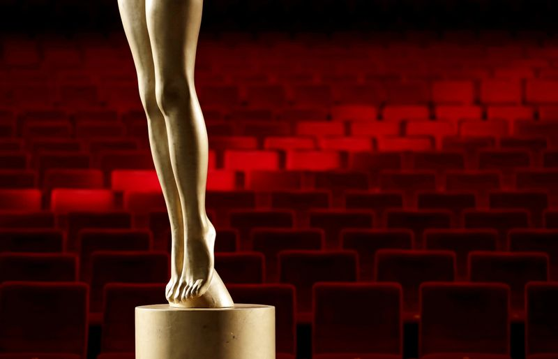 FILE PHOTO: Empty seats are seen behind a statue of the Crystal Globe Award inside a cinema in Karlovy Vary