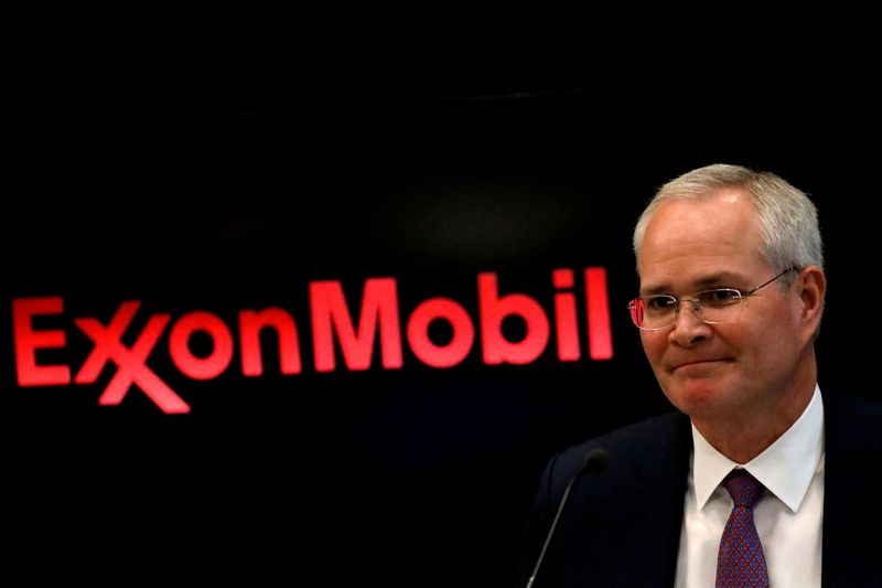 FILE PHOTO: Darren Woods, Chairman & CEO, Exxon Mobil Corporation attends a news conference at the NYSE