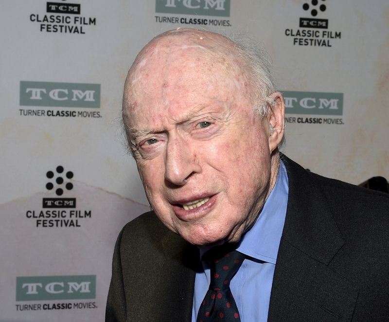 FILE PHOTO: Actor Norman Lloyd poses during 50th anniversary screening of musical drama film