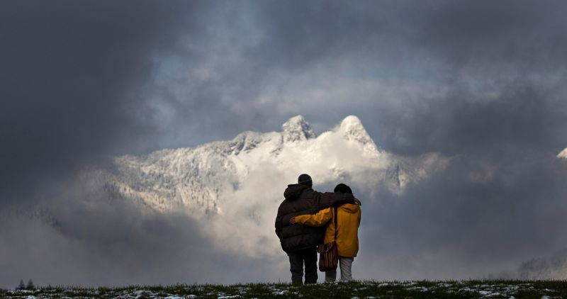 A couple admires the view in Canada's British Columbia