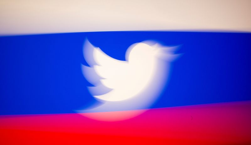 FILE PHOTO: Twitter logo and a Russian flag are displayed in this illustration picture