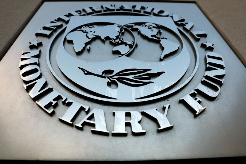 FILE PHOTO: The IMF logo is seen outside the headquarters building in Washington