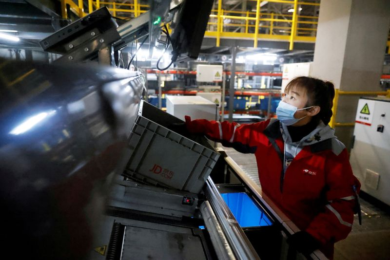 FILE PHOTO: JD.com's automated logistics center during a government organized tour on China's Singles Day shopping festival in Beijing