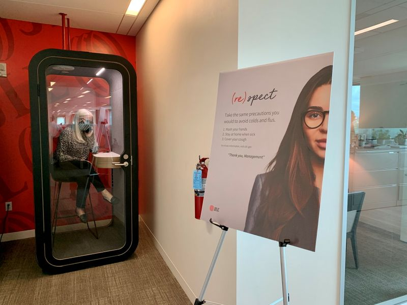 An employee makes a call in a newly-installed phone booth at real estate company JLL's Austin office