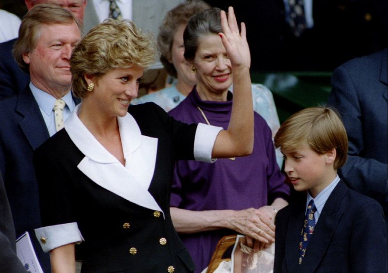 FILE PHOTO: The Princess of Wales, accompanied by her son Prince William, arrives at Wimbledon's Centre Court be..