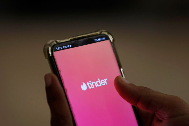 The dating app Tinder is shown on a mobile phone in this picture illustration