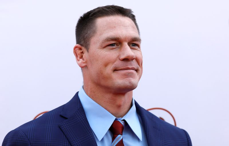 Cast member Cena poses at the premiere for