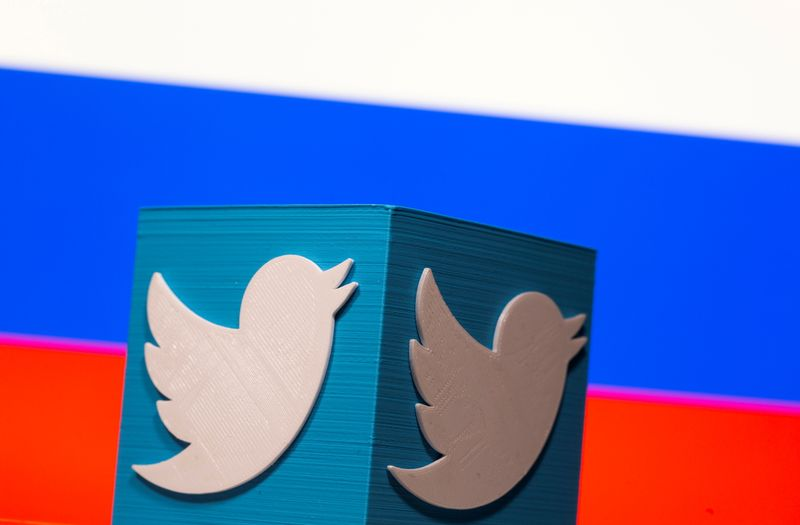 FILE PHOTO: A 3D-printed Twitter logo is pictured in front of a Russian flag in this illustration