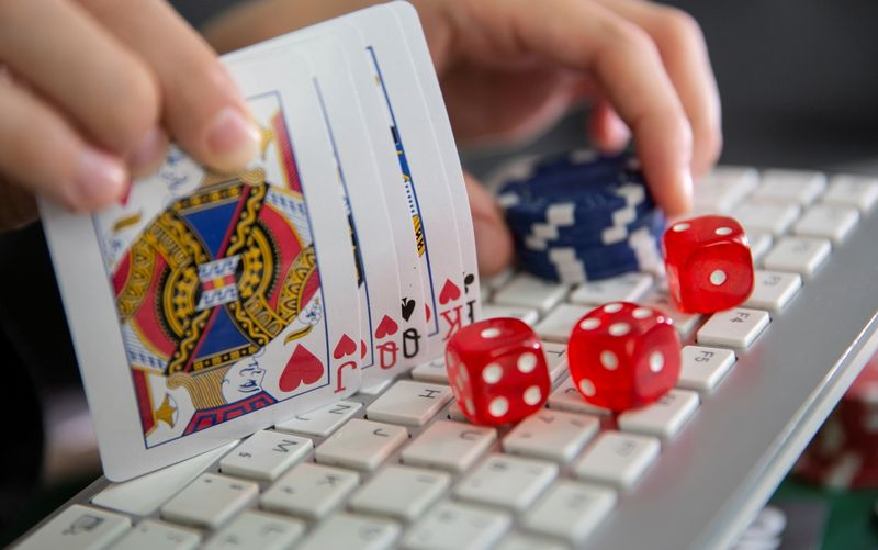 FILE PHOTO: Keyboard, cards, chips, dice are seen in this illustration picture