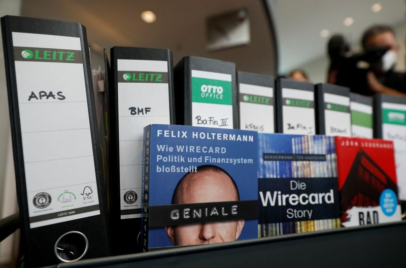 FILE PHOTO: Wirecard acts and books about the company are pictured, in Berlin