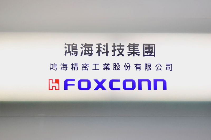 FILE PHOTO: A sign of Foxconn is seen inside its office building in Taipei