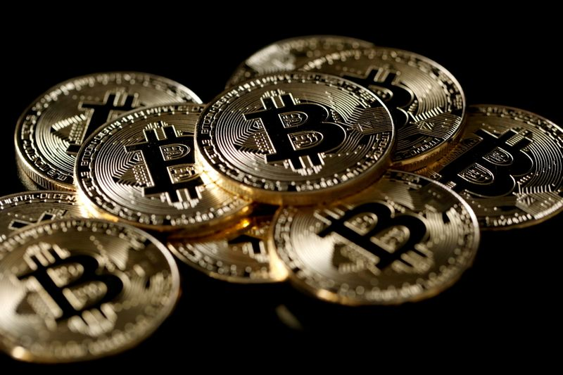 FILE PHOTO: A collection of virtual currency bitcoin tokens are displayed in this picture illustration