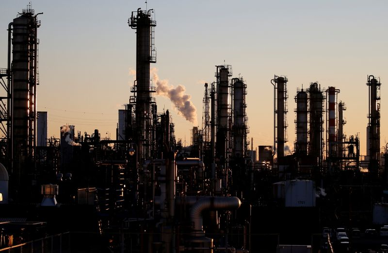 FILE PHOTO: Smoke rises from a factory during the sunset at Keihin industrial zone in Kawasaki
