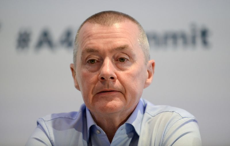 FILE PHOTO: Willie Walsh, head of the International Air Transport Association, attends a meeting in Brussels, Belgium