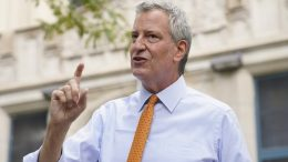 FILE - New York Mayor Bill de Blasio speaks to reporters after visiting New Bridges Elementary School in the Brooklyn borough of New York to observe pandemic-related safety procedures. (AP Photo/John Minchillo, File)
