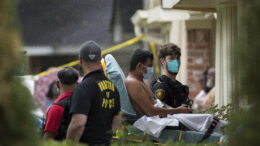 Paramedics transport a man into an ambulance from the scene of a human smuggling case, where more than 90 undocumented immigrants were found inside a home on the 12200 block of Chessington Drive, Friday, April 30, 2021, in Houston. A Houston Police official said the case will be handled by federal authorities and that some of the people inside the house were exhibiting COVID-19 symptoms. ( Godofredo A. Vásquez/Houston Chronicle via AP)