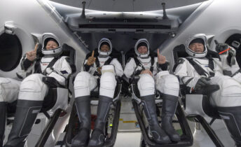 NASA astronauts Shannon Walker, left, Victor Glover, Mike Hopkins, and Japan Aerospace Exploration Agency (JAXA) astronaut Soichi Noguchi, right are seen inside the SpaceX Crew Dragon Resilience spacecraft onboard the SpaceX GO Navigator recovery ship shortly after having landed in the Gulf of Mexico off the coast of Panama City, Florida, Sunday, May 2, 2021. NASA's SpaceX Crew-1 mission was the first crew rotation flight of the SpaceX Crew Dragon spacecraft and Falcon 9 rocket with astronauts to the International Space Station as part of the agency's Commercial Crew Program. (Bill Ingalls/NASA via AP)