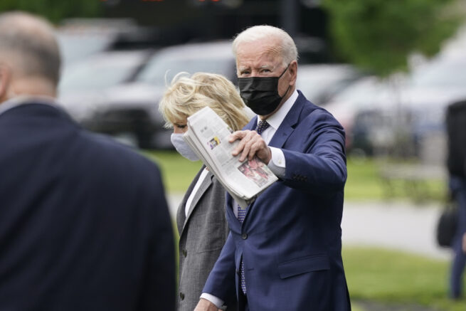 President Joe Biden and first lady Jill Biden arrive to board Marine One on the Ellipse near the White House, Monday, May 3, 2021, in Washington. The Bidens are en route to Virginia. (AP Photo/Patrick Semansky)