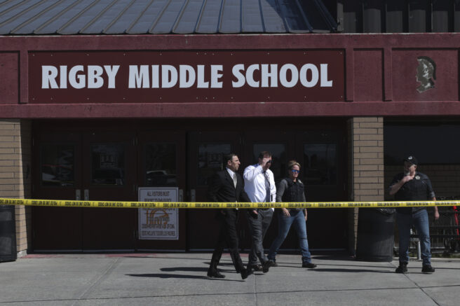 Officers leave Rigby Middle School after a  shooting in Rigby, Idaho on Thursday, May 6, 2021. Authorities say a shooting at the eastern Idaho middle school has injured two students and a custodian, and a female student has been taken into custody.  (John Roark /The Idaho Post-Register via AP)