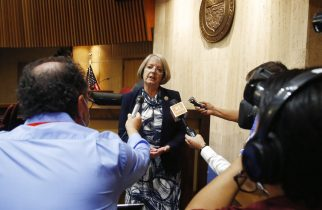 FILE - In this May 26, 2020, file photo, Arizona Senate President Karen Fann, R-Prescott, speaks to the media in Phoenix. The Republican president of the Arizona Senate said in a letter to the U.S. Justice Department that ballots it is recounting from November's presidential election are secure and the department's worries about voter intimidation are unfounded. Fann's Friday, May 7, 2021, letter comes two days after the head of the department's Civil Rights Division sought assurances from the Senate that 2.1 million ballots from the state's most populous county are being secured as federal law requires. (AP Photo/Ross D. Franklin, File)