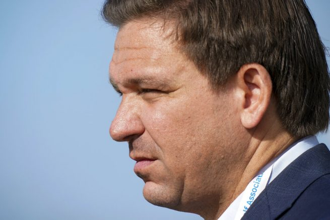 Gov. Ron DeSantis, of Florida, watches the foursome matches during the Walker Cup golf tournament at the Seminole Golf Club on Saturday, May 8, 2021, in Juno Beach, Fla. (AP Photo/Brynn Anderson)