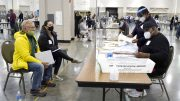 FILE - In this Nov. 20, 2020, file photo, election workers, right, verify ballots as recount observers, left, watch during a Milwaukee hand recount of presidential votes at the Wisconsin Center, in Milwaukee. The Republican-controlled Wisconsin Legislature was scheduled to vote Tuesday, May 11, 2021, on bills making it more difficult to vote absentee, proposals that are all-but certain to be vetoed by Democratic Gov. Tony Evers but that GOP lawmakers say are needed to address issues that arose in last year's presidential election. (AP Photo/Nam Y. Huh, File)