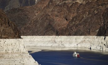 """FILE - In this Oct. 14, 2015, file photo, a riverboat glides through Lake Mead on the Colorado River at Hoover Dam near Boulder City, Nev. California Gov. Gavin Newsom has expanded a drought emergency declaration to a large swath of the nation's most populated state amid """"acute water supply shortages"""" in northern and central areas. Monday May 10, 2021 declaration now covers 41 of the 58 counties, covering 30% of California's nearly 40 million people. (AP Photo/Jae C. Hong, File)"""