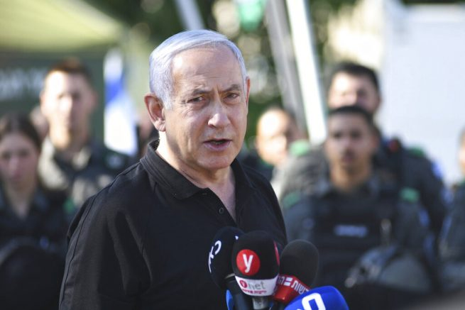 Israeli Prime Minister Benjamin Netanyahu meets with Israeli border police on Thursday, May 13, 2021 in Lod, near Tel Aviv after a wave of violence in the city the night before. Jewish and Arab mobs battled in the central city of Lod, the epicenter of the troubles, despite a state of emergency and nighttime curfew. (AP Photo/Yuval Chen, Yediot Ahronot, Pool)